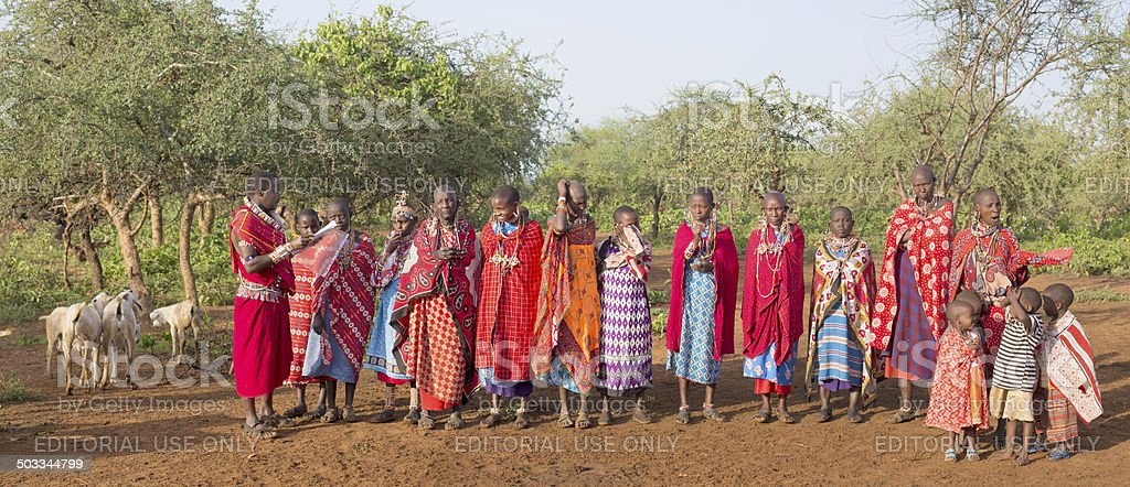 Masai man reading to group of woman and children. stock photo