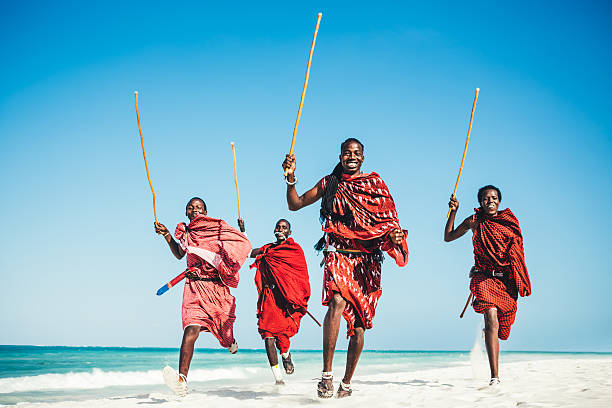 masai people running on the beach.jpg - warrior person stock pictures, royalty-free photos & images