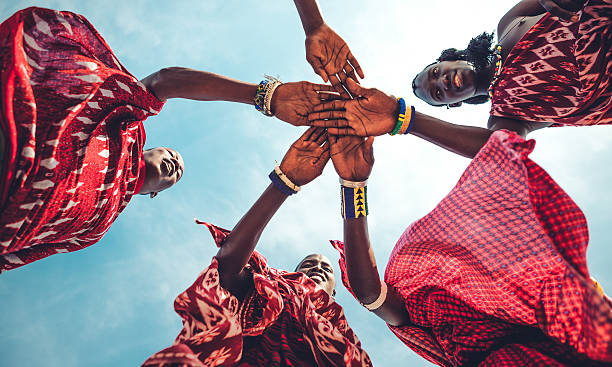 Masai Unity Masai in traditional clothes joining hands in unity (Zanzibar, Tanzania), east africa stock pictures, royalty-free photos & images
