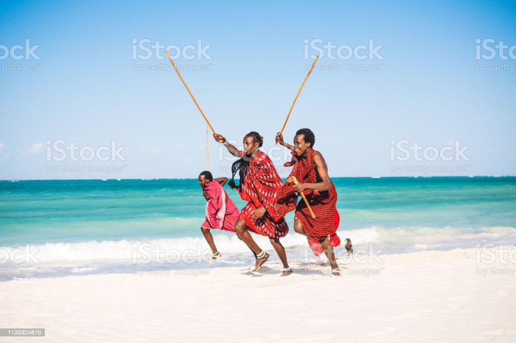 Masai Warriors On The Beach stock photo