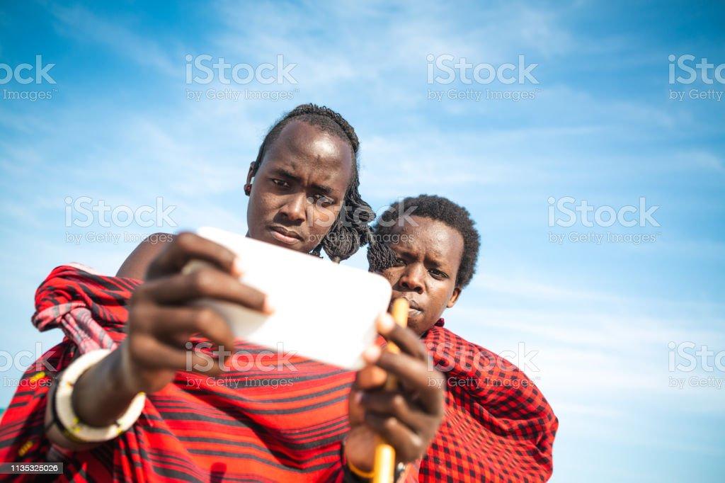 Masai With Smartphone stock photo