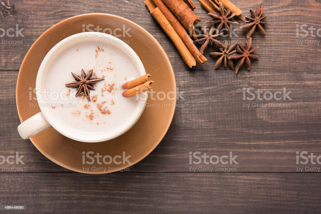 Masala chai on the wooden background. stock photo