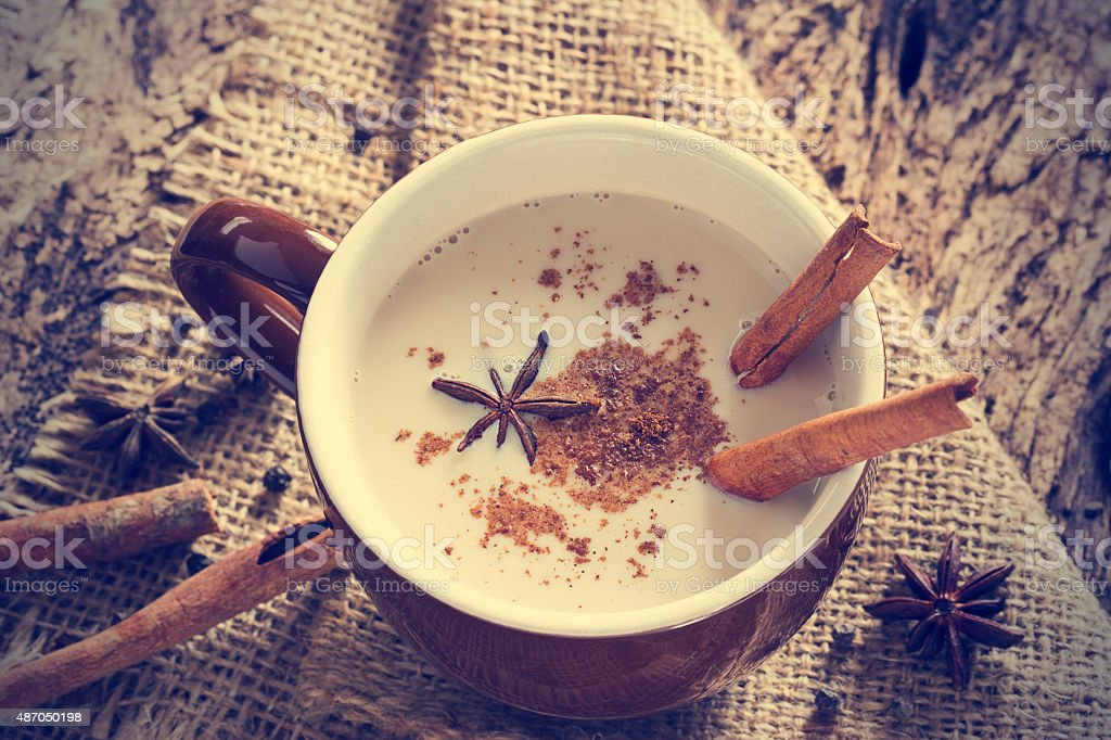 masala chai tea with spices and star Anise, cinnamon stick stock photo