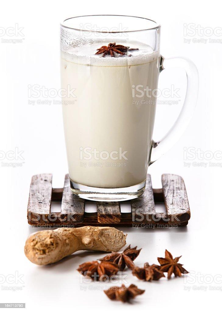 Masala tea on wooden coaster on white stock photo
