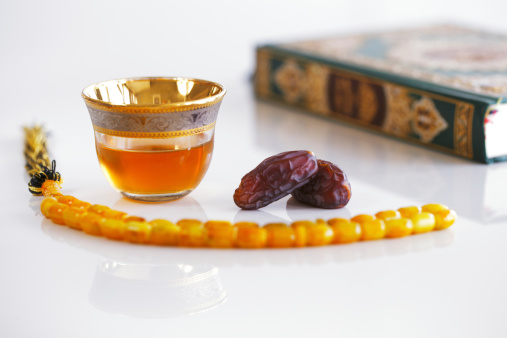 Masbaha, Quran, Arabic tea and dried dates