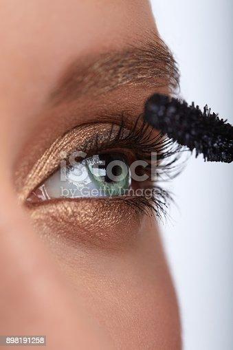 istock Mascara Applying. Long Lashes closeup. Mascara Brush. Makeup for Green Eyes. Eye Make up Apply. Beautiful woman eyes make-up. 898191258
