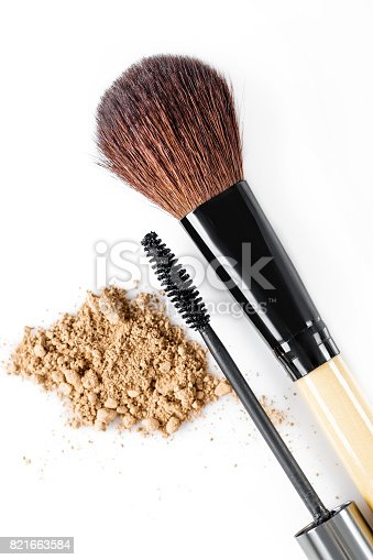 istock Mascara, beige powder for face and makeup brush  on white background 821663584
