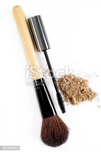 istock Mascara, beige powder for face and makeup brush  on white background 821663610