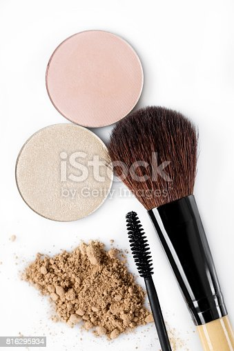 istock Mascara, beige powder for face, eye shadow and makeup brush  on white background 816295934