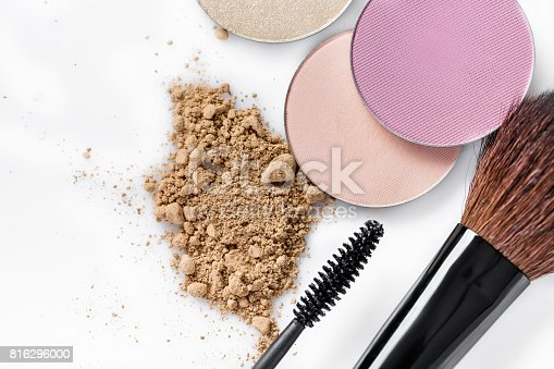 istock Mascara, beige powder for face, eye shadow and makeup brush  on white background 816296000