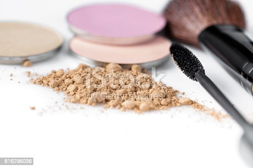 istock Mascara, beige powder for face, eye shadow and makeup brush  on white background 816296036