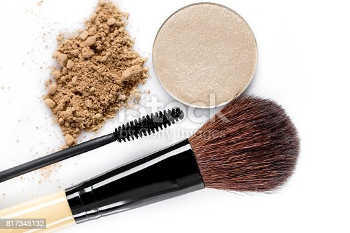 istock Mascara, beige powder for face, eye shadow and makeup brush  on white background 817345132
