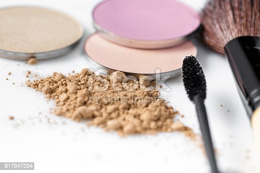 istock Mascara, beige powder for face, eye shadow and makeup brush  on white background 817347204