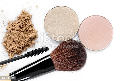 istock Mascara, beige powder for face, eye shadow and makeup brush  on white background 821184154