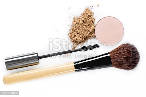 istock Mascara, beige powder for face, eye shadow and makeup brush  on white background 821663638