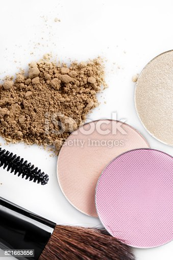 istock Mascara, beige powder for face, eye shadow and makeup brush  on white background 821663656