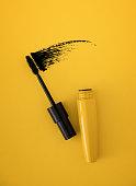 istock Mascara brush on yellow background 1209043417