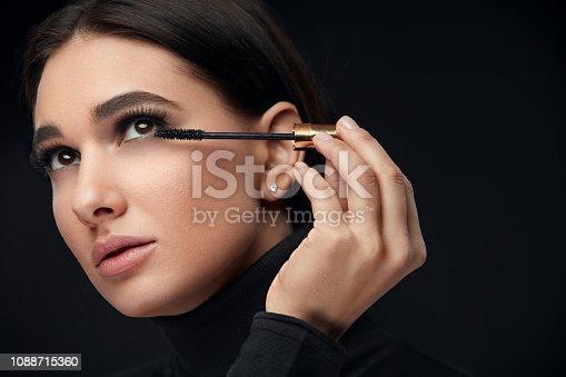 istock Mascara Makeup. Beauty Model Putting Black Mascara On Eyelashes 1088715360