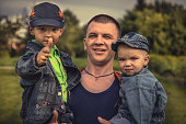 Masculine cheerful father sons family lifestyle portrait concept happy paternity