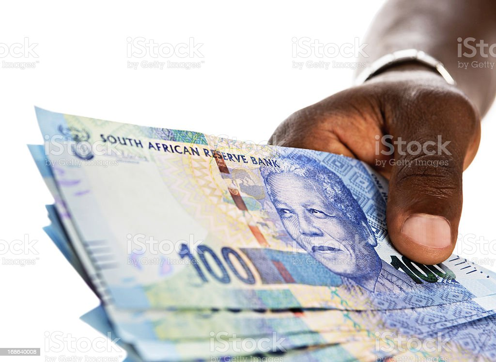 Masculine hand holds out bundle of Hundred Rand banknotes royalty-free stock photo