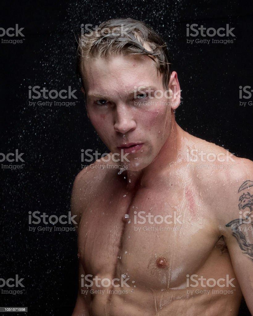 Masculine man taking a shower - headshot stock photo