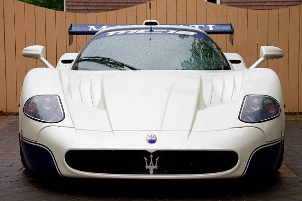 Maserati MC-12 Parked in front of wooden fence stock photo