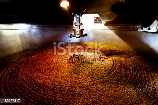 Wooden mash tun and dissolving vats producing beer in a traditional Dorset brewery