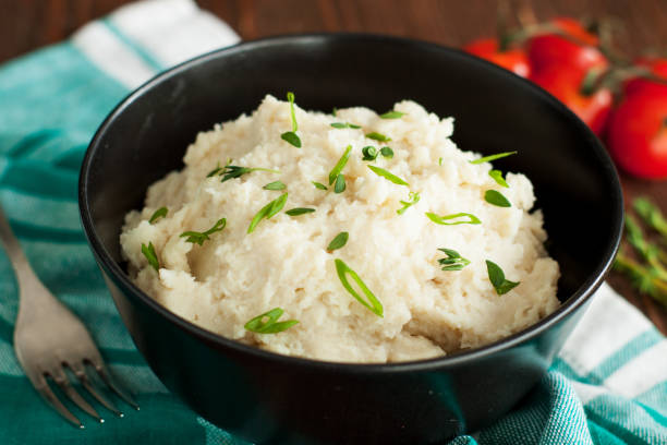 Mashed cauliflower with garlic and herbs stock photo