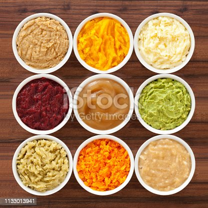 Nine bowls with varieties of mashed foods