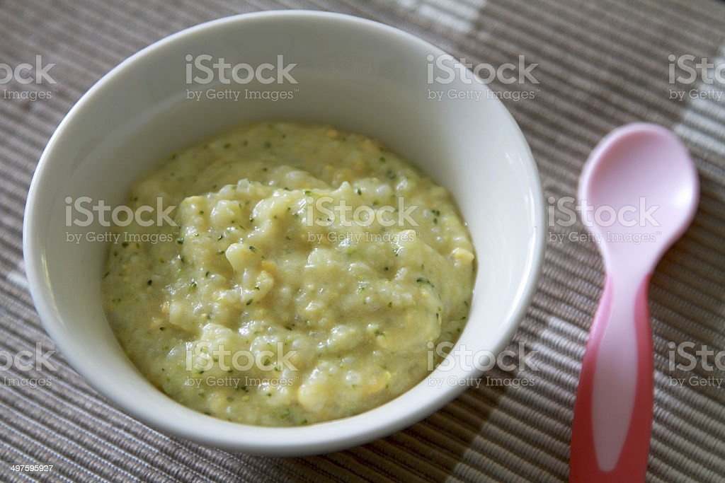Mashed or puree baby food with pink spoon stock photo