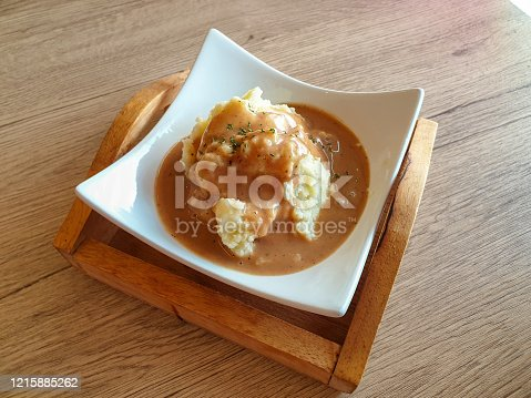 Mashed Potato with Gravy Sauce in white bowl.