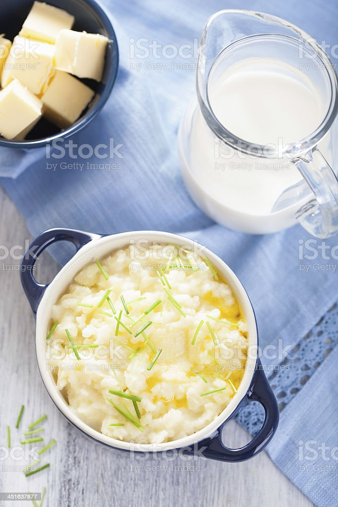 mashed potatoes in small pot stock photo