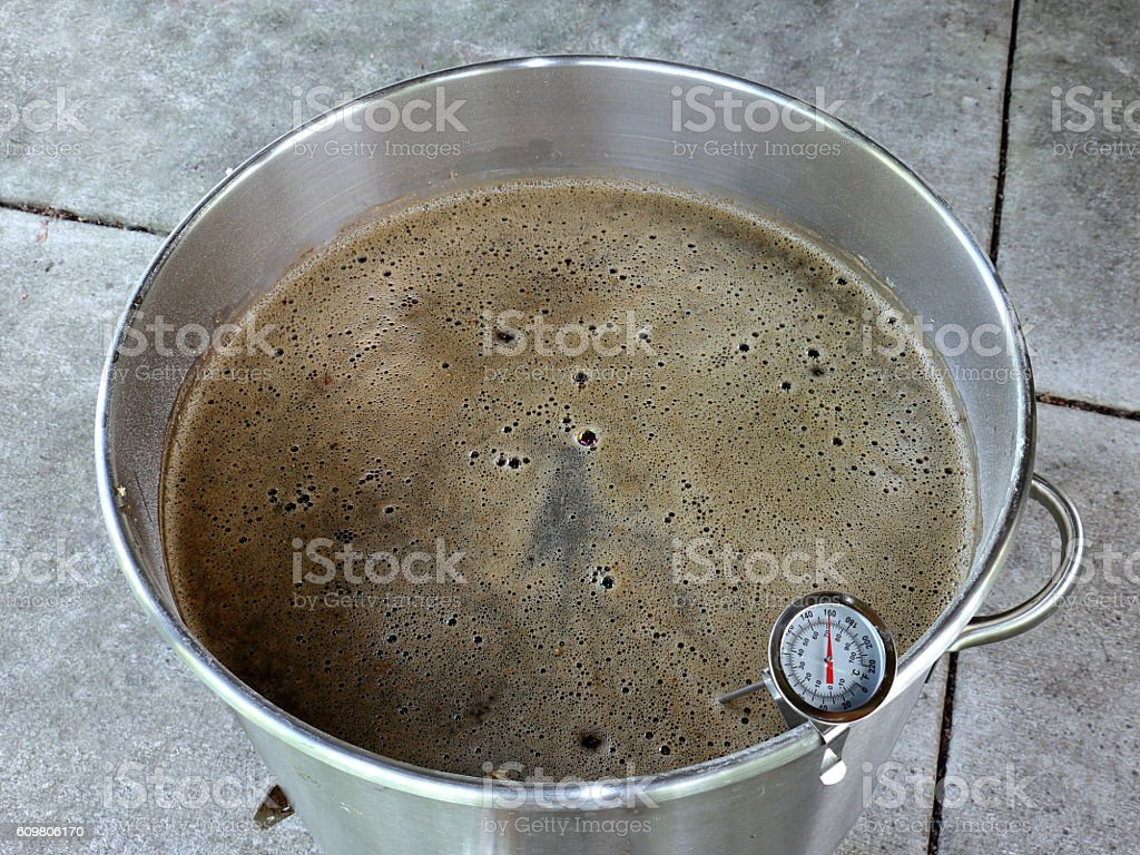 Mashing Malted Grain to Make Beer stock photo