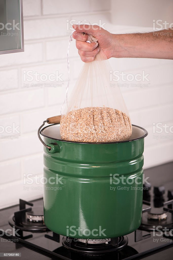 Mashing procedure. Malted grain immerse for beer production. stock photo