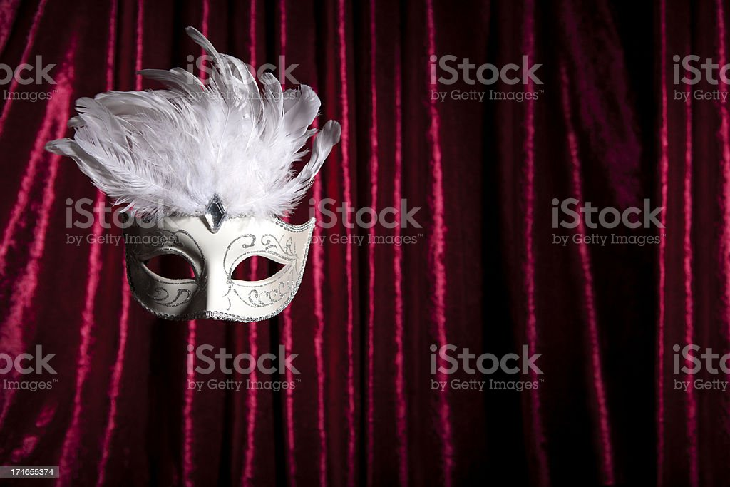 Mask and red curtain royalty-free stock photo