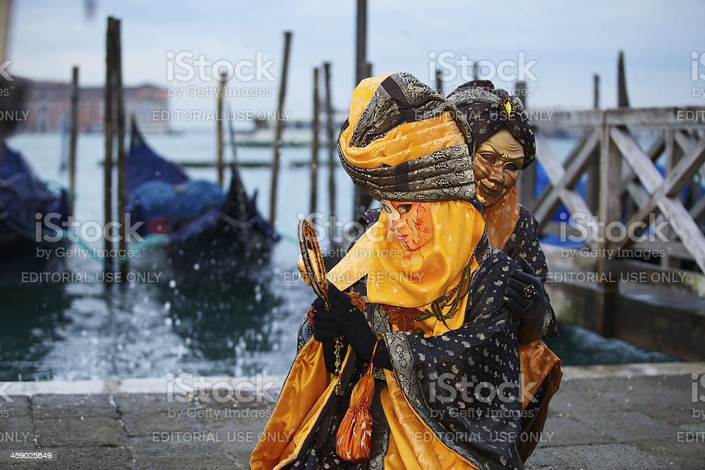 Mask at Venice Carnival 2013 in St. Mark's basin royalty-free stock photo