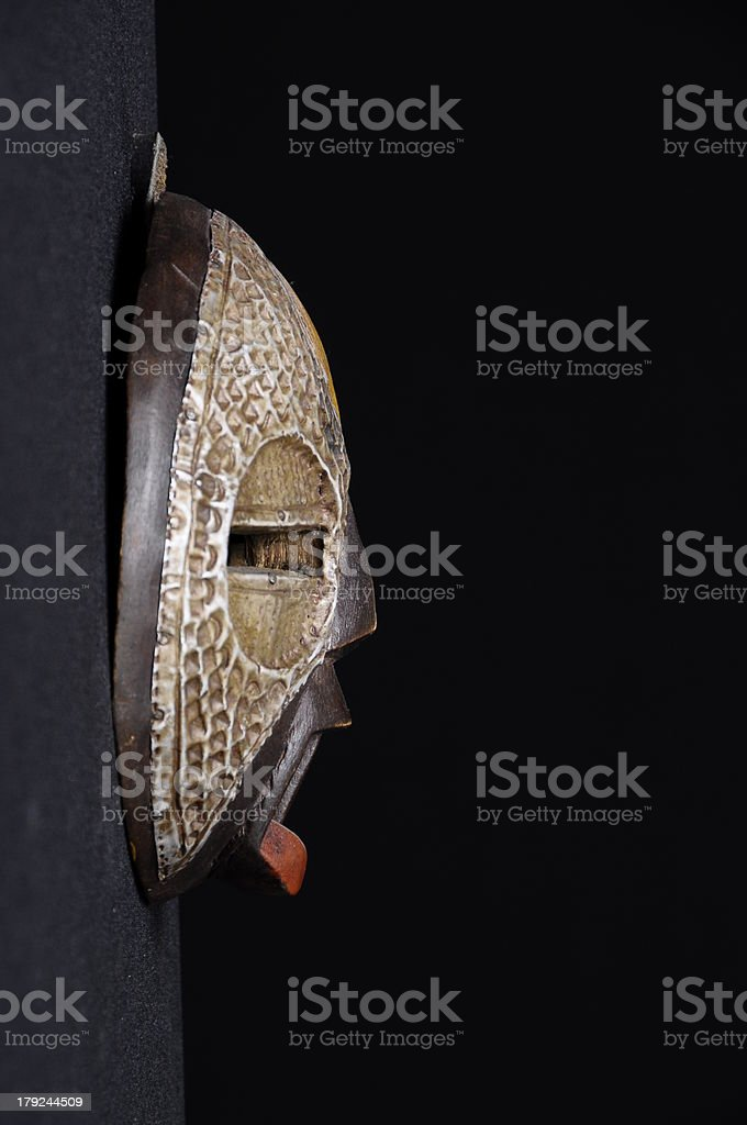 Mask in front of dark background stock photo