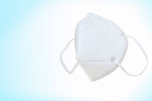 N95 Mask on blue background with work path stock photo