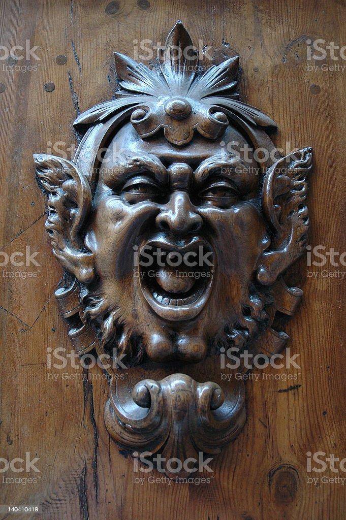 Mask on door with open mouth and mischievous air stock photo