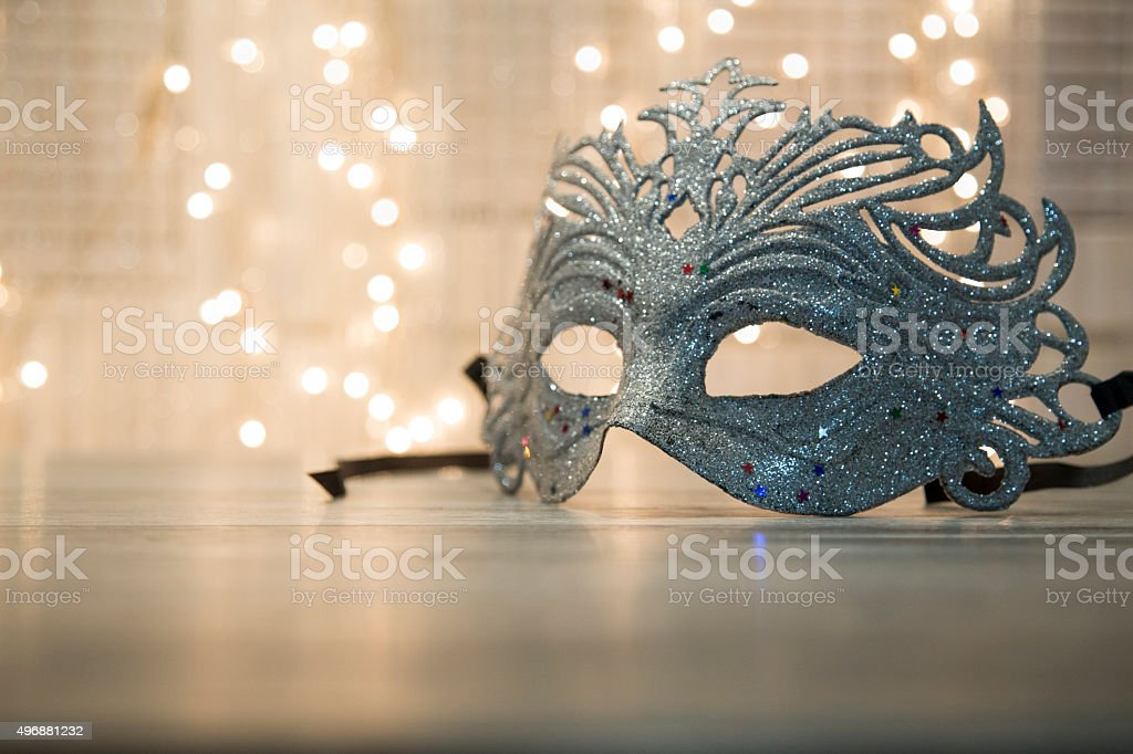 Mask with glittering backround stock photo