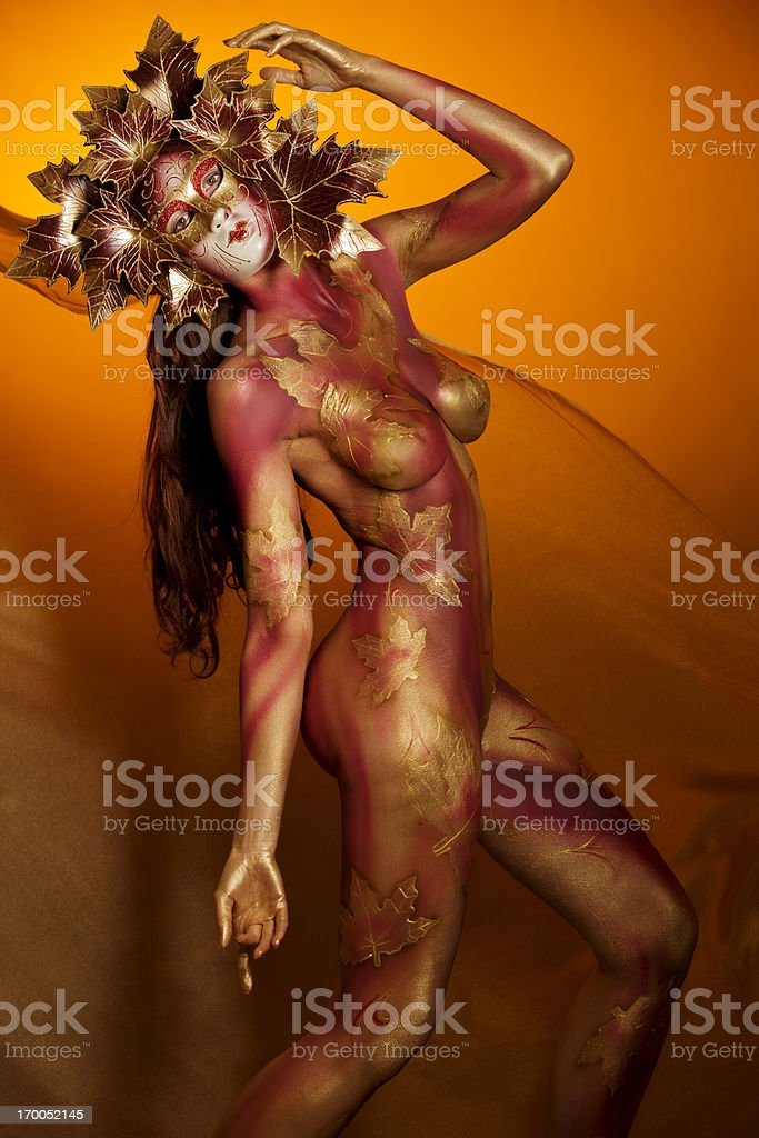 Masked Beauty: woman with bodypainting wearing a mask royalty-free stock photo