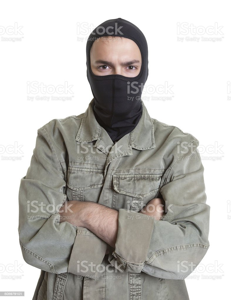 Masked burglar with crossed arms stock photo