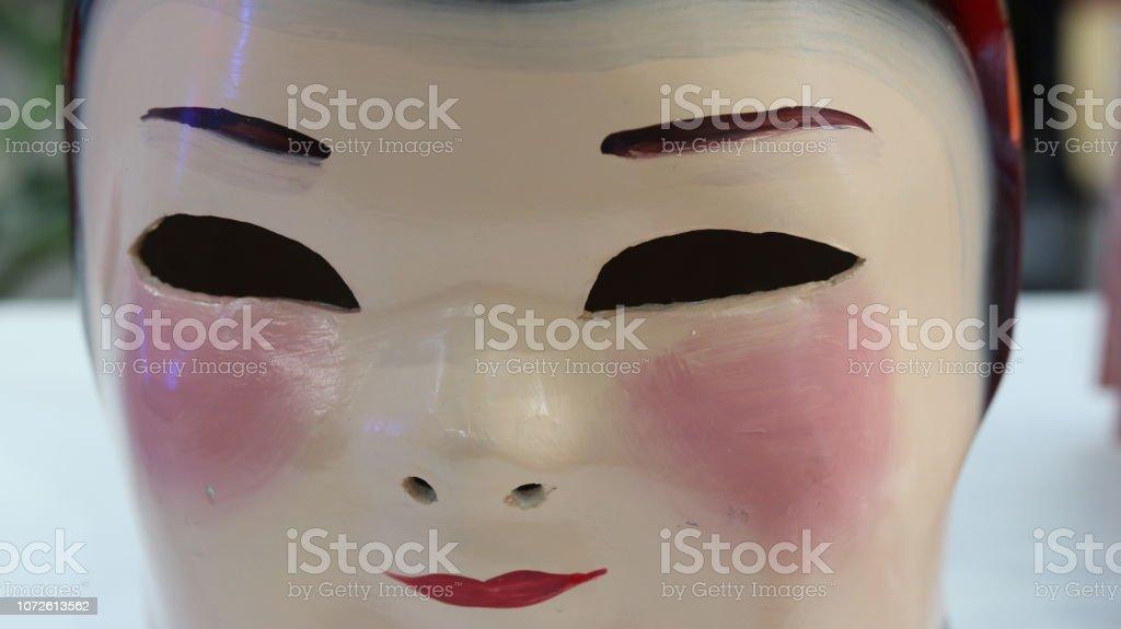 Máscara sonriente chino - foto de stock