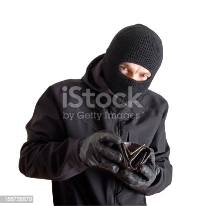 istock Masked criminal holding a stolen leather purse, isolated on white 158738870