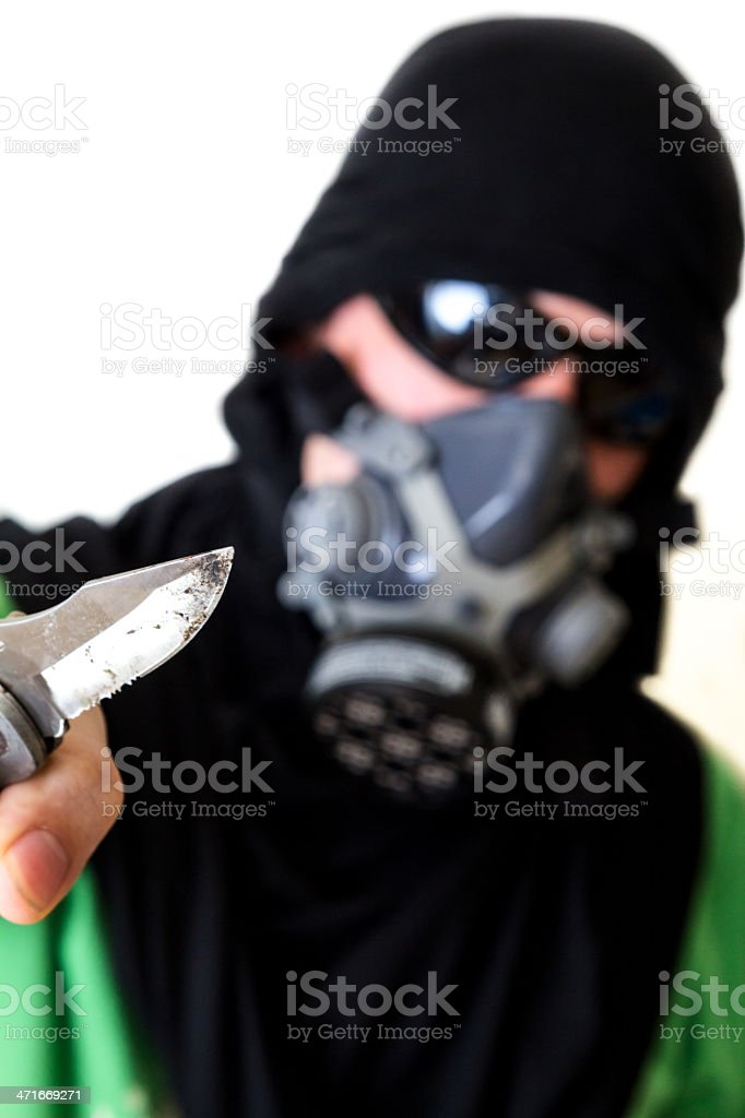 Masked criminal with knife royalty-free stock photo