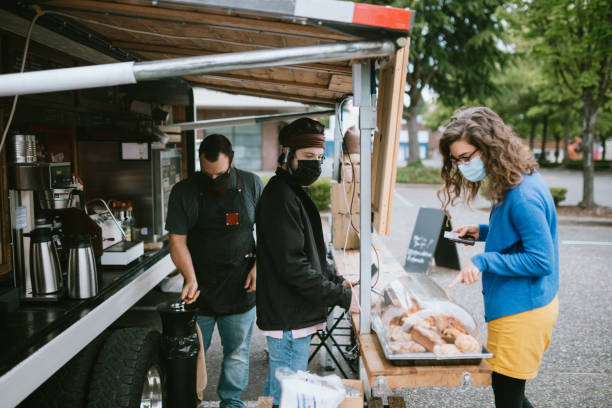Masked Customer Orders Coffee And Snacks at Food Truck