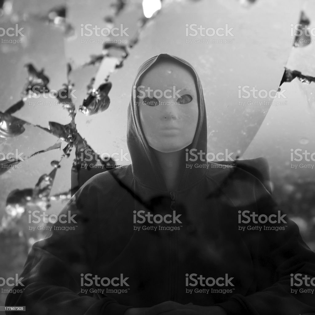 masked figure broken mirror royalty-free stock photo