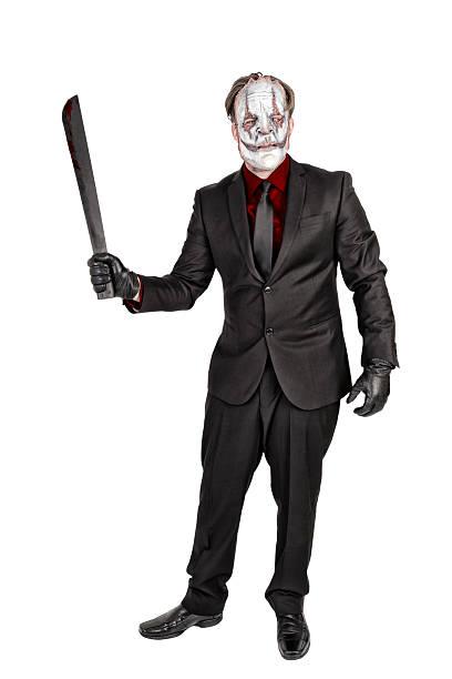 Masked killer in elegant suit - foto de acervo