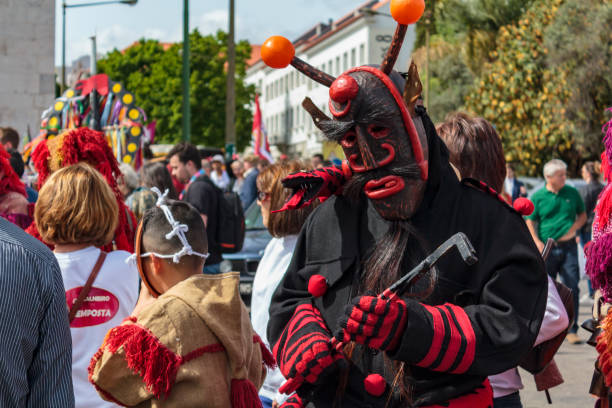 masked man at iberian mask festival parade in lisbon - demoniac stock pictures, royalty-free photos & images