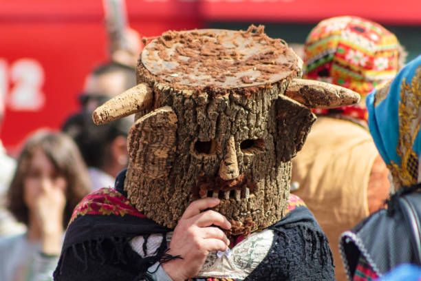 masked man at iberian mask international festival in lisbon - demoniac stock pictures, royalty-free photos & images